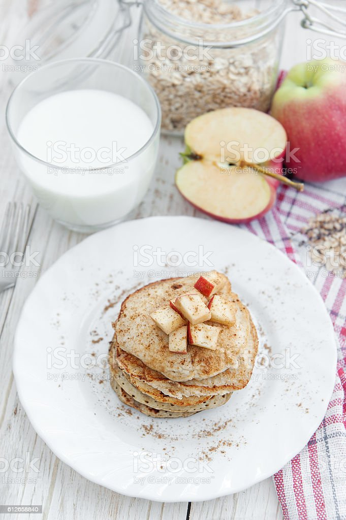 Oatmeal pancakes with apple and honey. stock photo