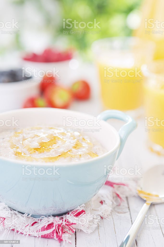 Oatmeal porridge on a rustic table, brightly lit royalty-free stock photo