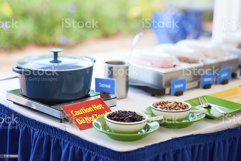 Oatmeal porridge with nuts and dried fruits royalty-free stock photo