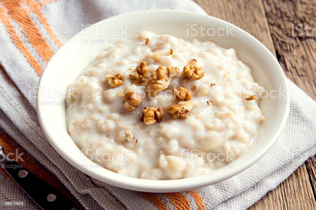 oatmeal porridge with walnuts stock photo