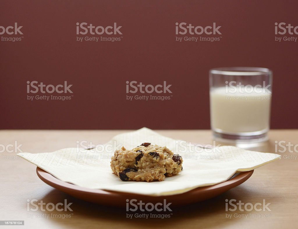 Oatmeal raisin cookie with a glass of milk stock photo