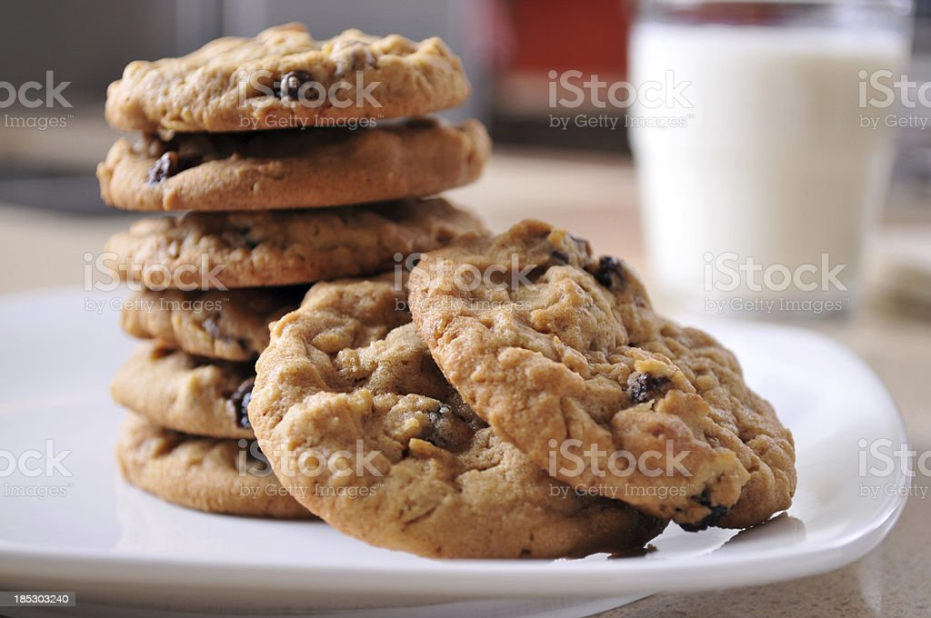 Oatmeal Raisin Cookies on a Plate with Glass of Milk stock photo