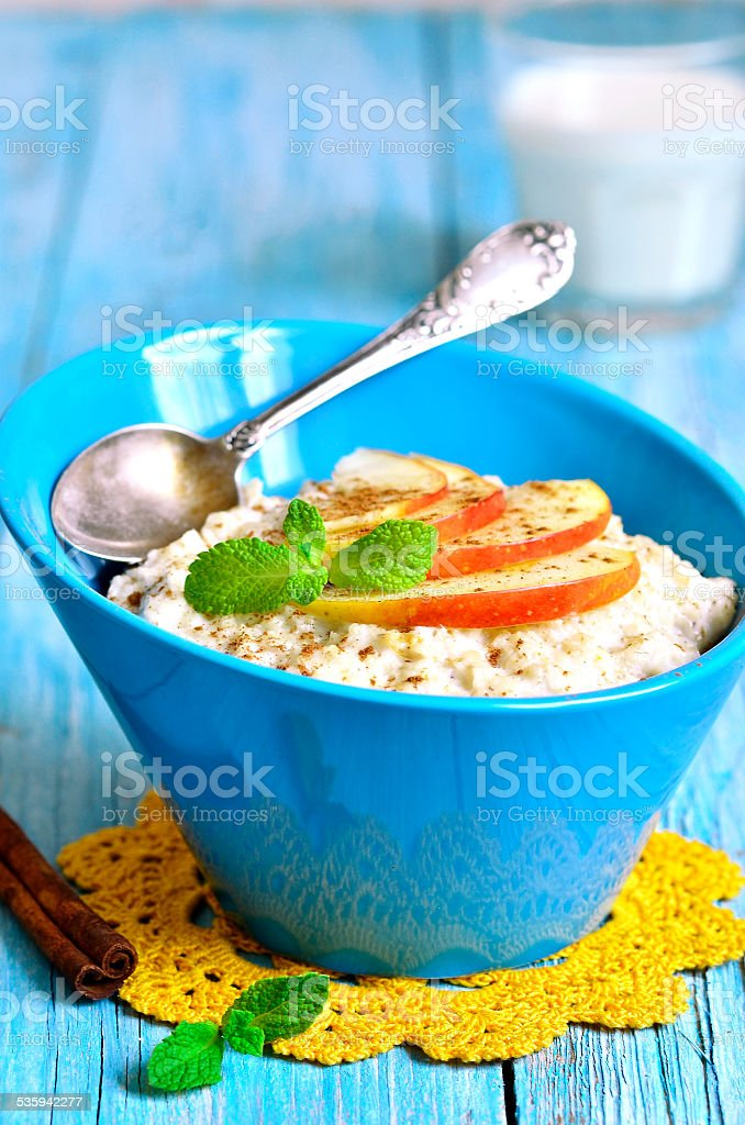 Oatmeal with apple and cinnamon. stock photo