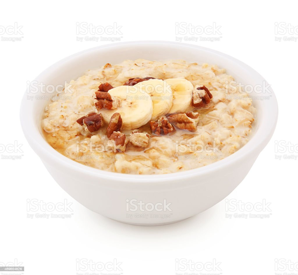 Oatmeal with banana, nuts and honey (with path) stock photo