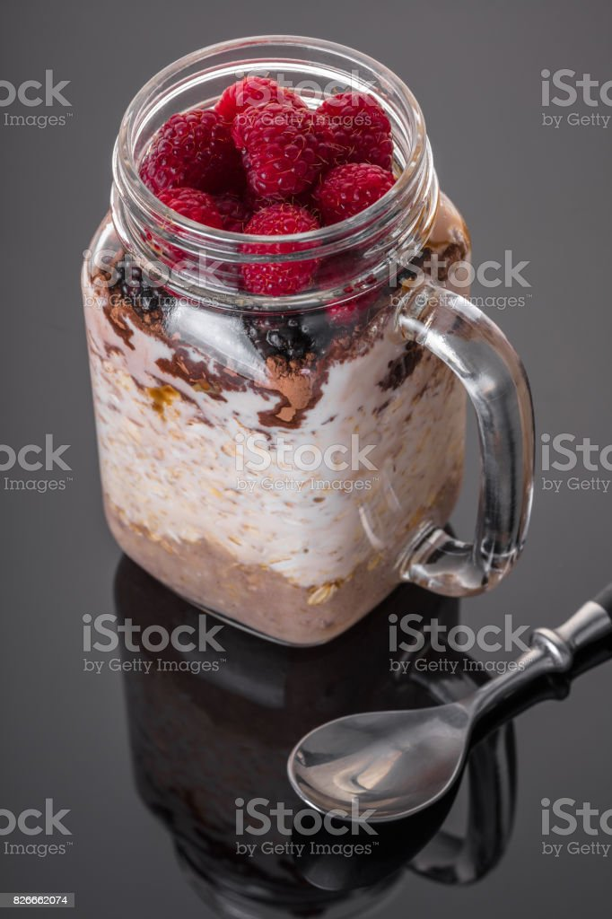 Oatmeal with berries in a jar stock photo