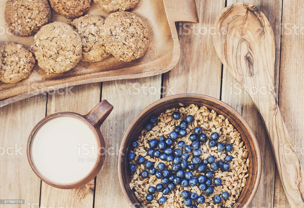 Oatmeal with blueberries and milk stock photo