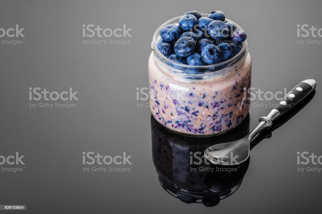 Oatmeal with blueberries in jar stock photo