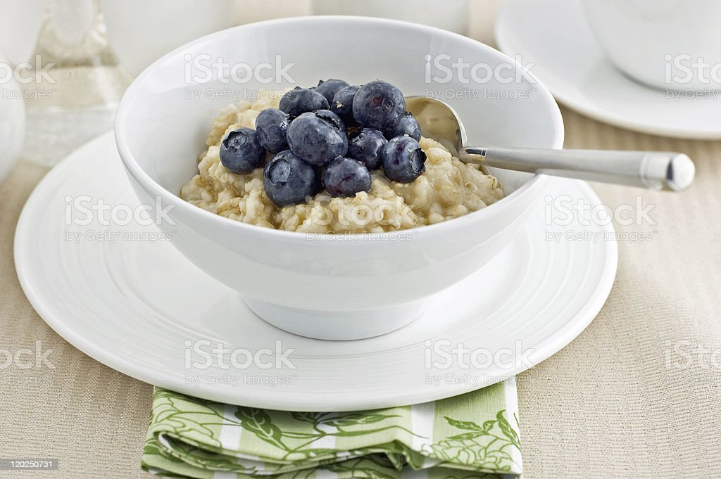 Oatmeal with blueberries stock photo