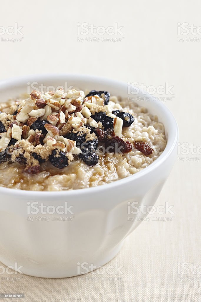 Oatmeal with brown sugar, almonds, and raisins royalty-free stock photo