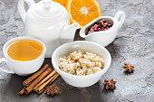 Oatmeal with cinnamon for breakfast, fresh orange, sweet sauce,