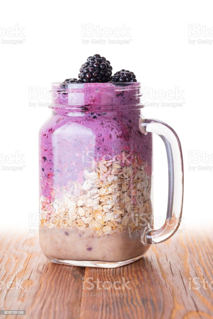 Oatmeal with fruit and fresh berries stock photo