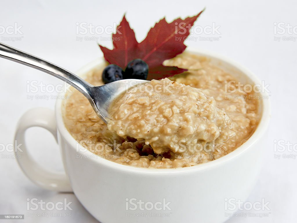 Oatmeal With Fruit and Maple Leaf stock photo