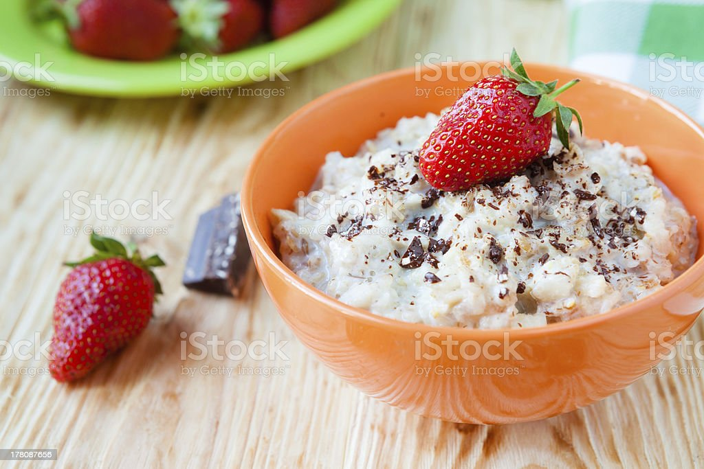 oatmeal with milk and strawberries royalty-free stock photo