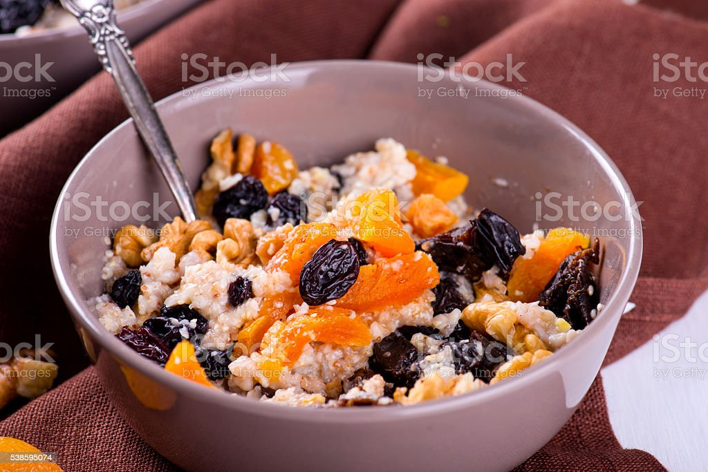 Oatmeal with raisins, dried apricots, plums stock photo