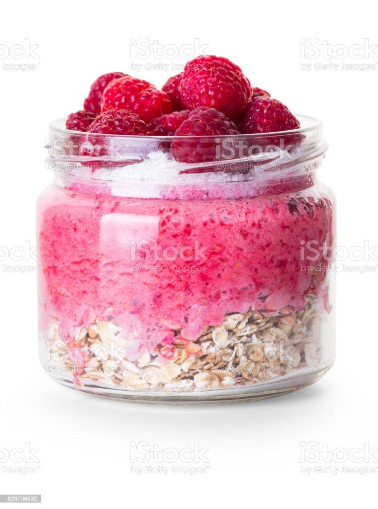 Oatmeal with raspberries in a jar stock photo