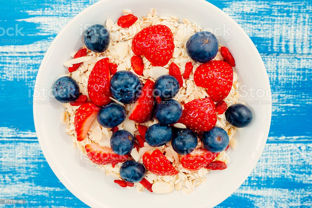 Oats and berry fruit breakfast stock photo