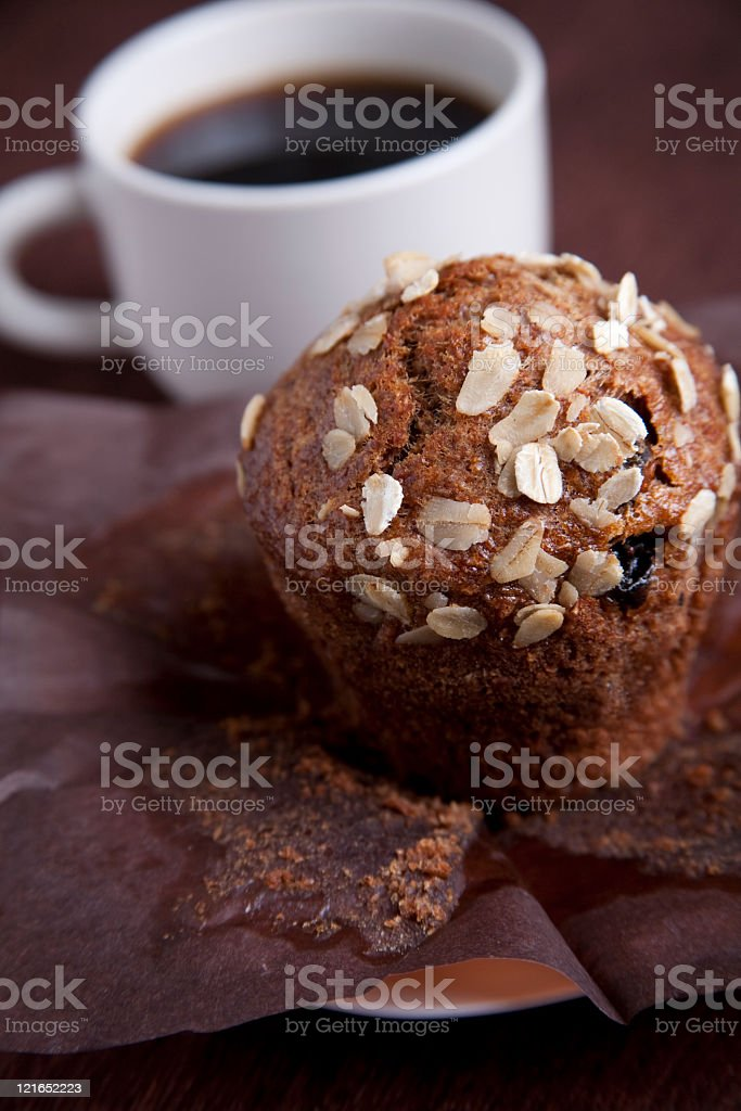 oats and raisin muffin with a black cup of coffee royalty-free stock photo