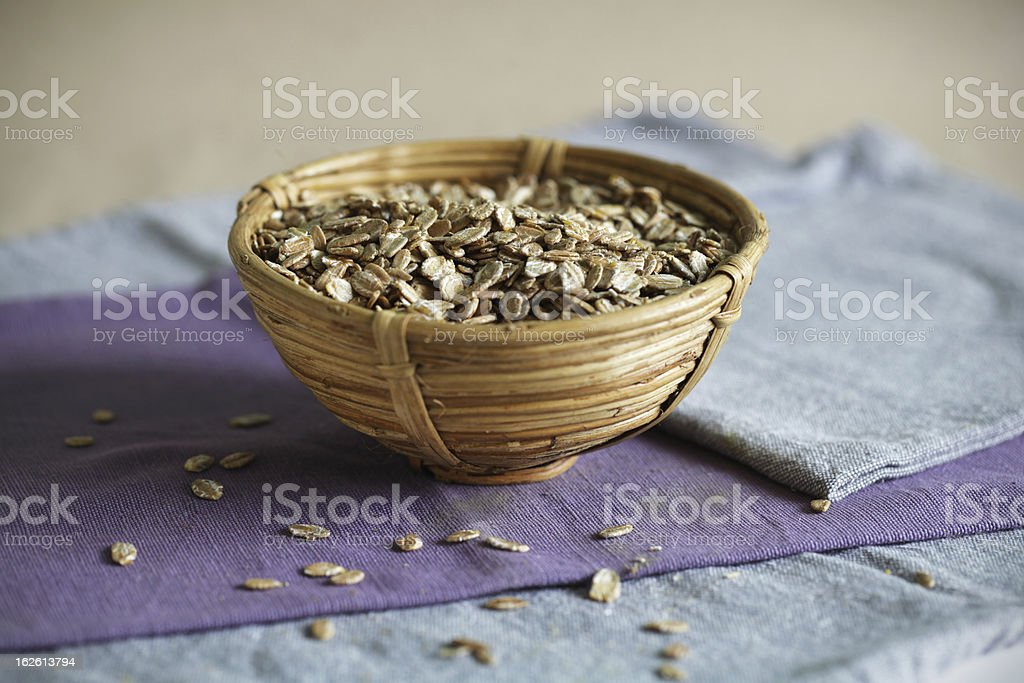 Oats or oatmeal cereal of rye in a cup, breakfast stock photo