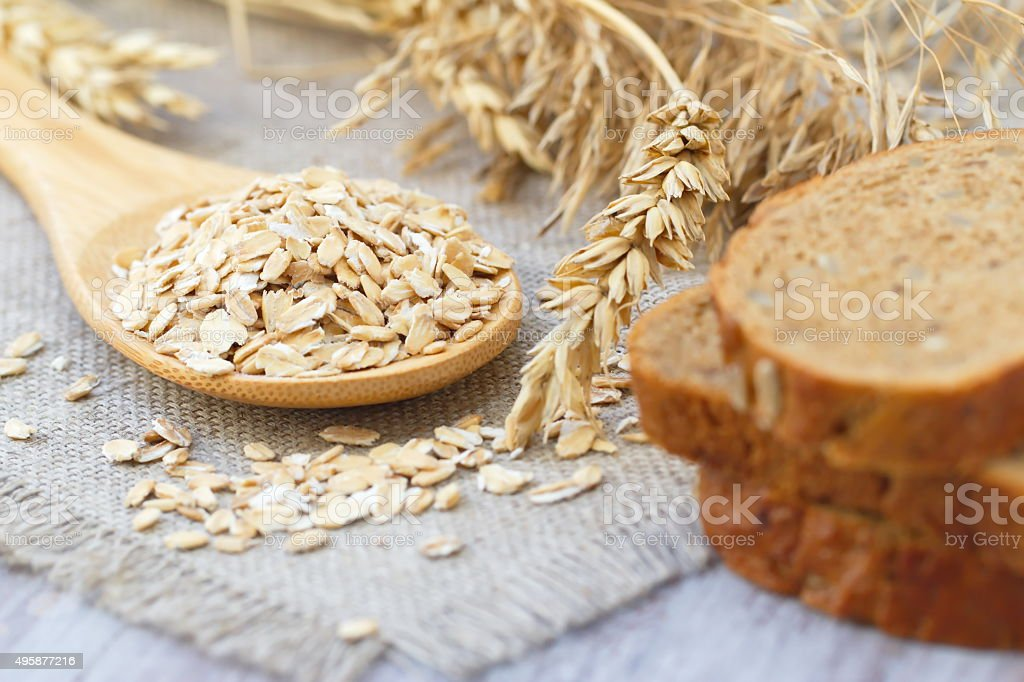 Oats with ears of cereal and bread stock photo