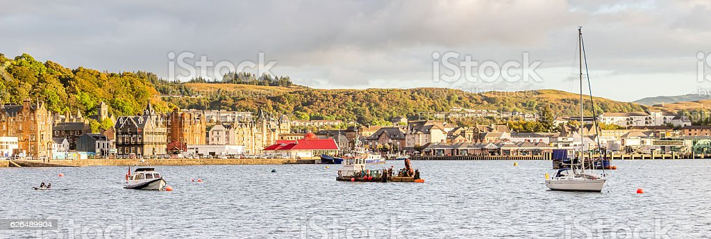 Oban sunlighted waterfront bay stock photo