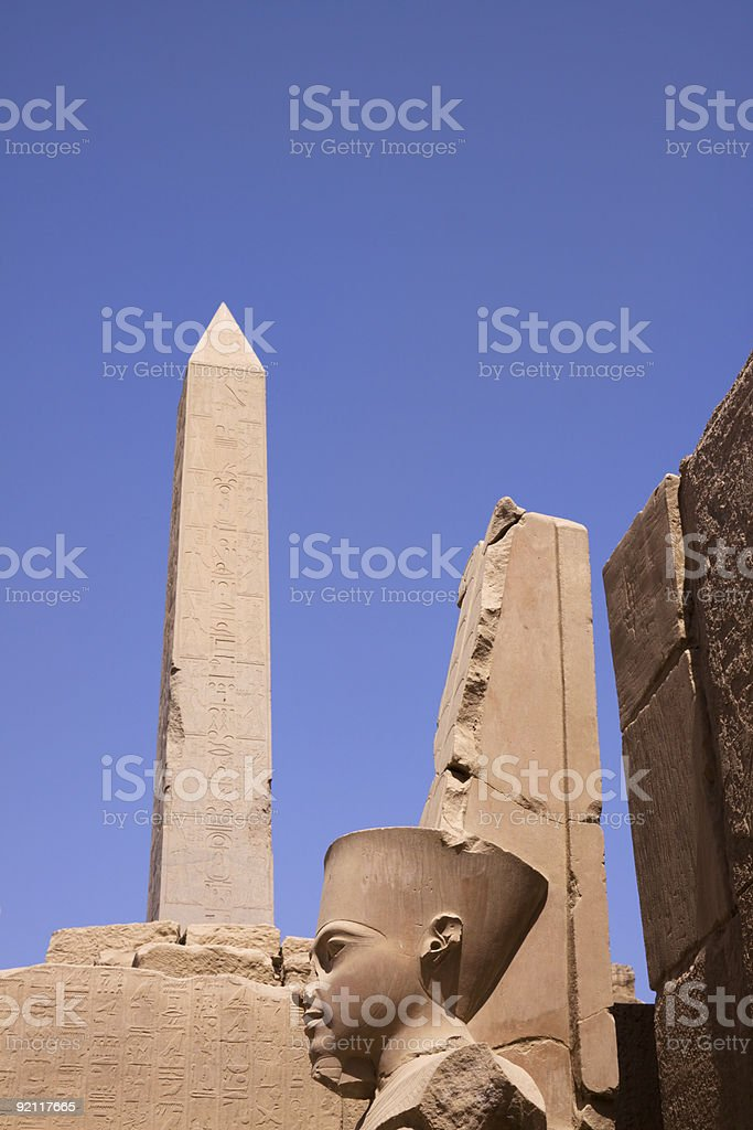 obelisk and statue face egypt royalty-free stock photo