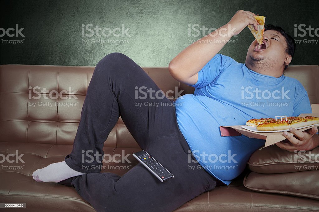 Obese person eats pizza 3 stock photo