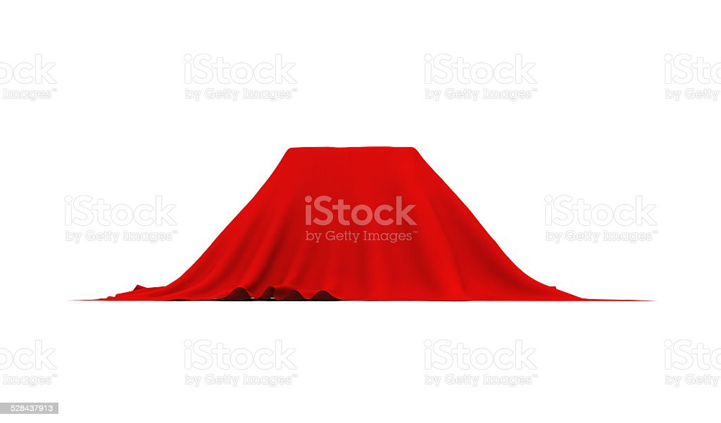 Object of rectangular shape covered with red cloth, on white stock photo