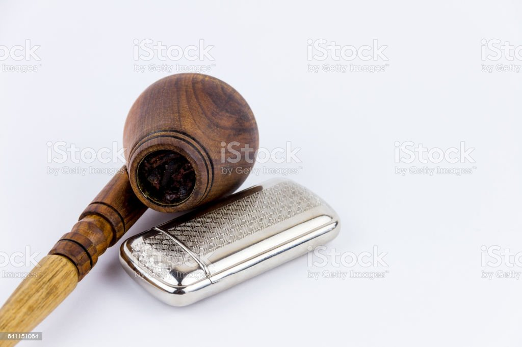 Object photography of a lighter and a wooden pipe stock photo