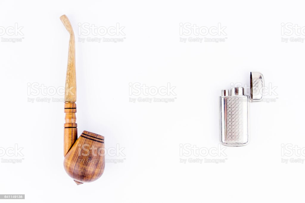 Object photography of a lighterand a tobacco pipe stock photo