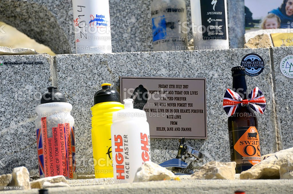 objects left by cyclists on the Tom Simpson memorial stone stock photo