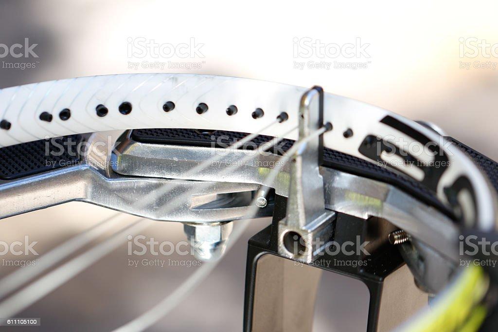 Objects: Man stringing tennis racket stock photo