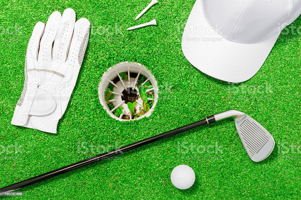 objects such as golf course lie on the green grass stock photo