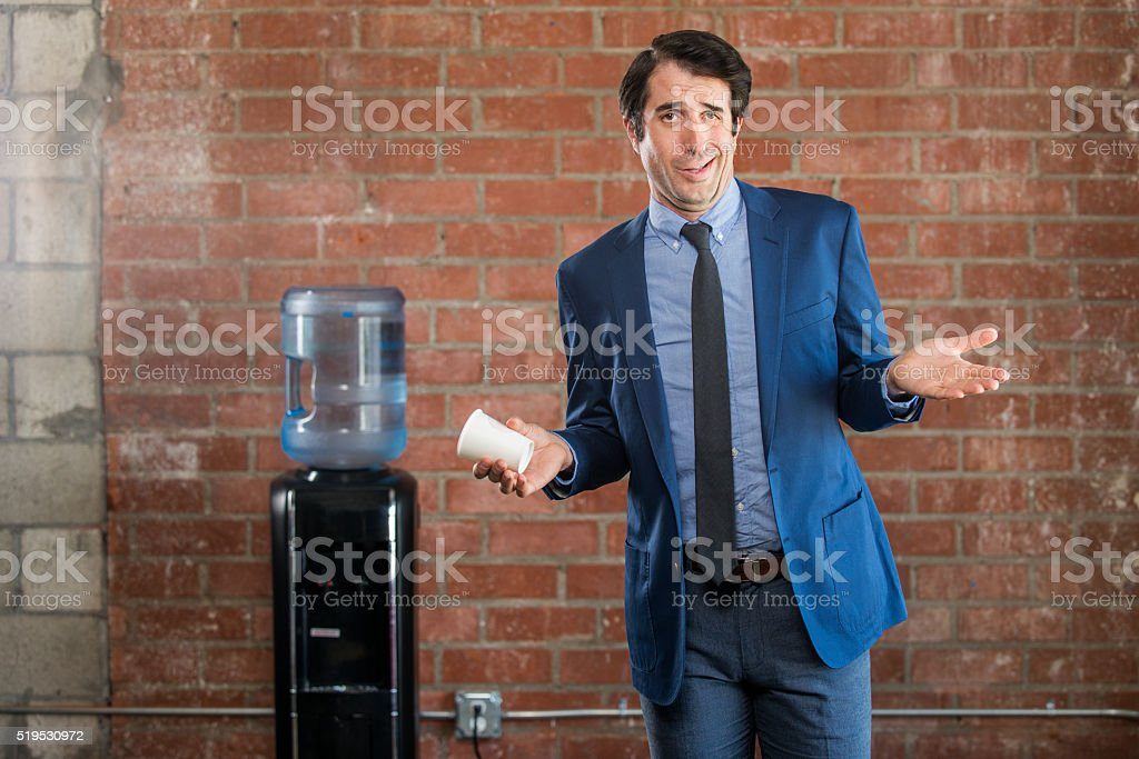 Obnoxious Nerdy Businessman at Water Cooler stock photo