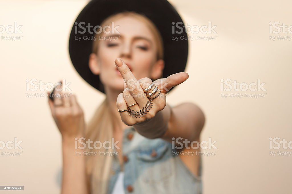 Obscene hand gesture stock photo