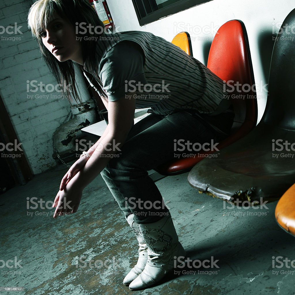 Obscure Lighting On Young Indie Girl In Chair. royalty-free stock photo