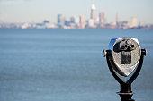 Observation deck binoculars overlooking a distant Cleveland