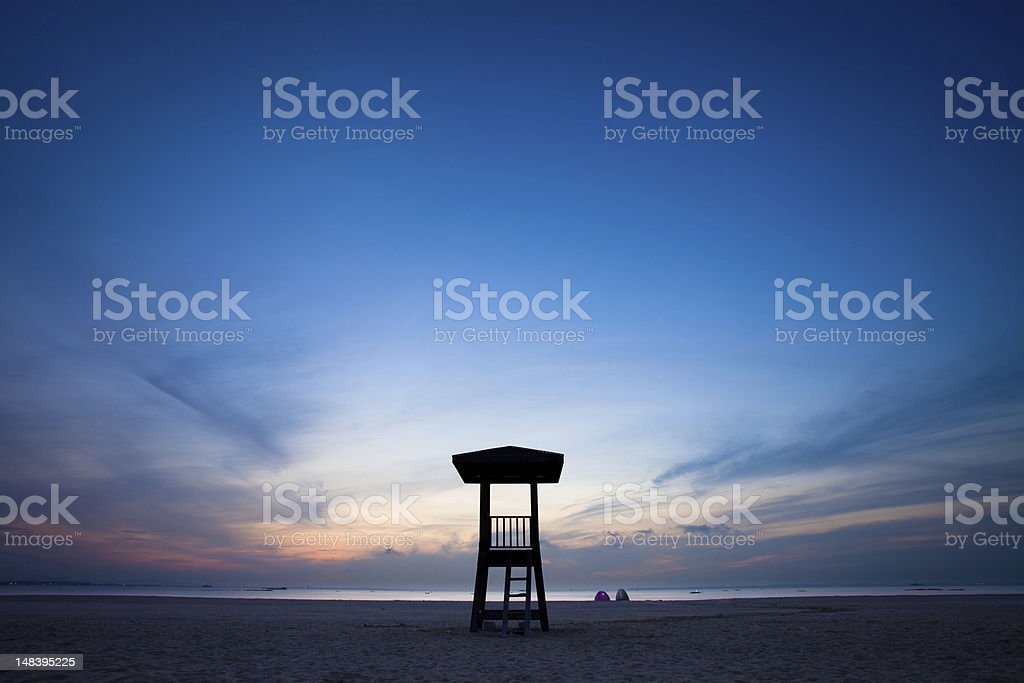 Observation tower on the beach with sunrise royalty-free stock photo