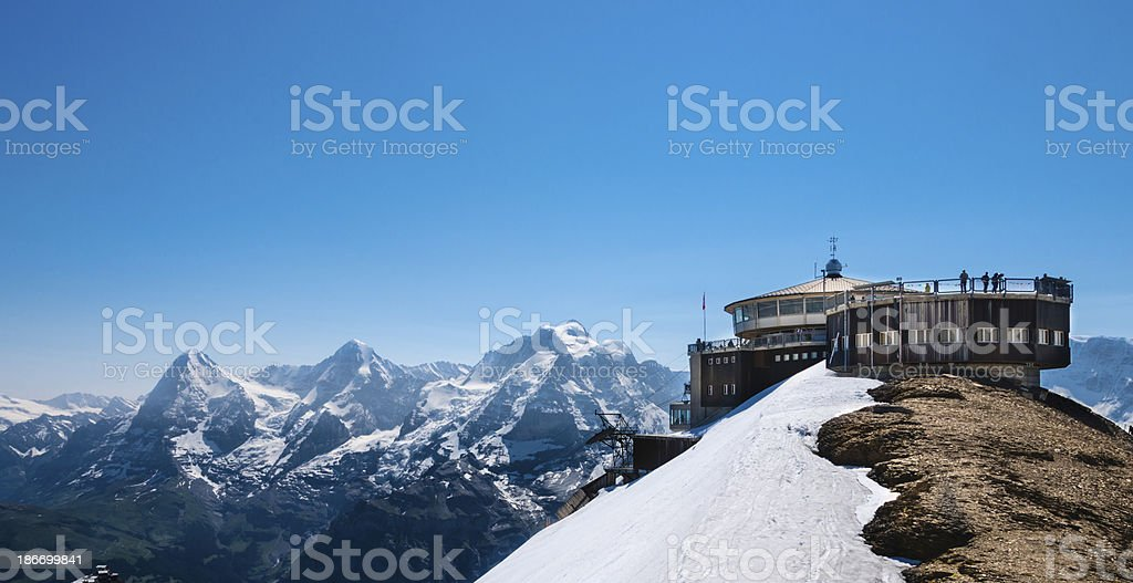 Observatory on top of snowy mountain in Switzerland stock photo