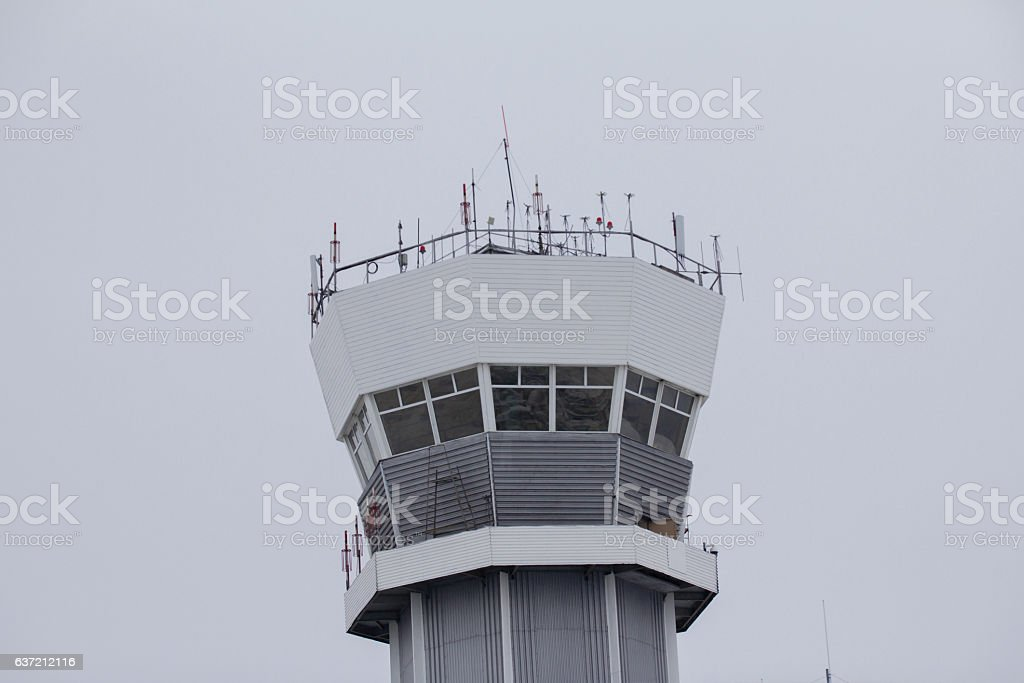 Observe airport tower in cloudy sky stock photo