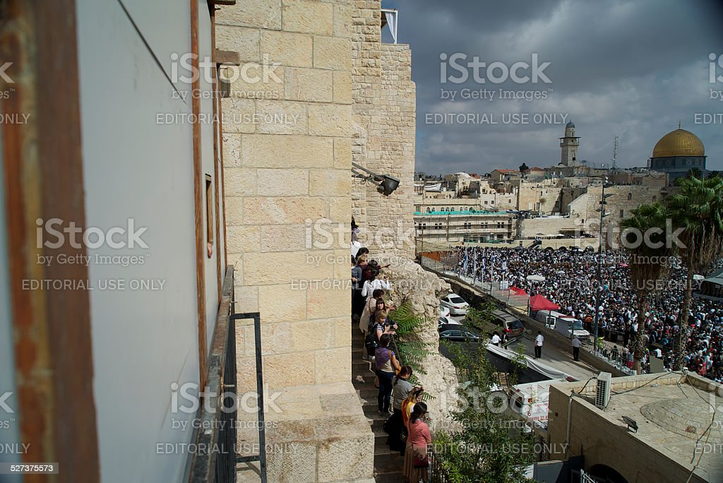 Observing the Western Wall Crowd stock photo