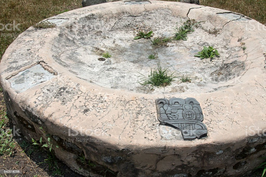 Obsidian inlay on a stone altar at Caracol in Belize stock photo