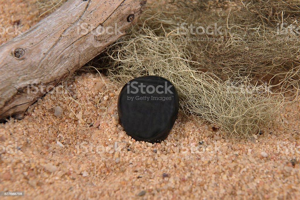 Obsidian on beach stock photo