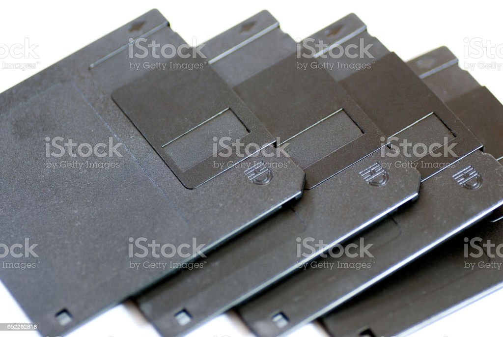 obsolete 3.5 inch floppy disk aligned stock photo