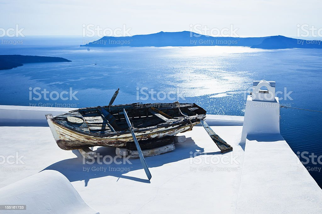 Obsolete boat on roof, Santorini island royalty-free stock photo