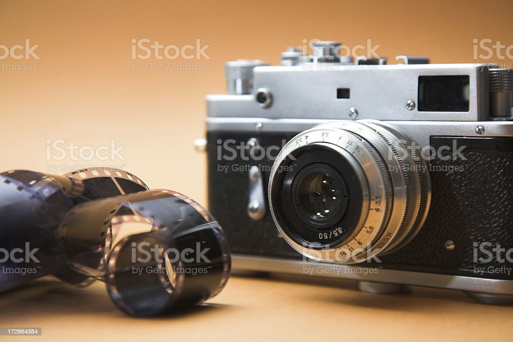 obsolete film camera with negatives royalty-free stock photo