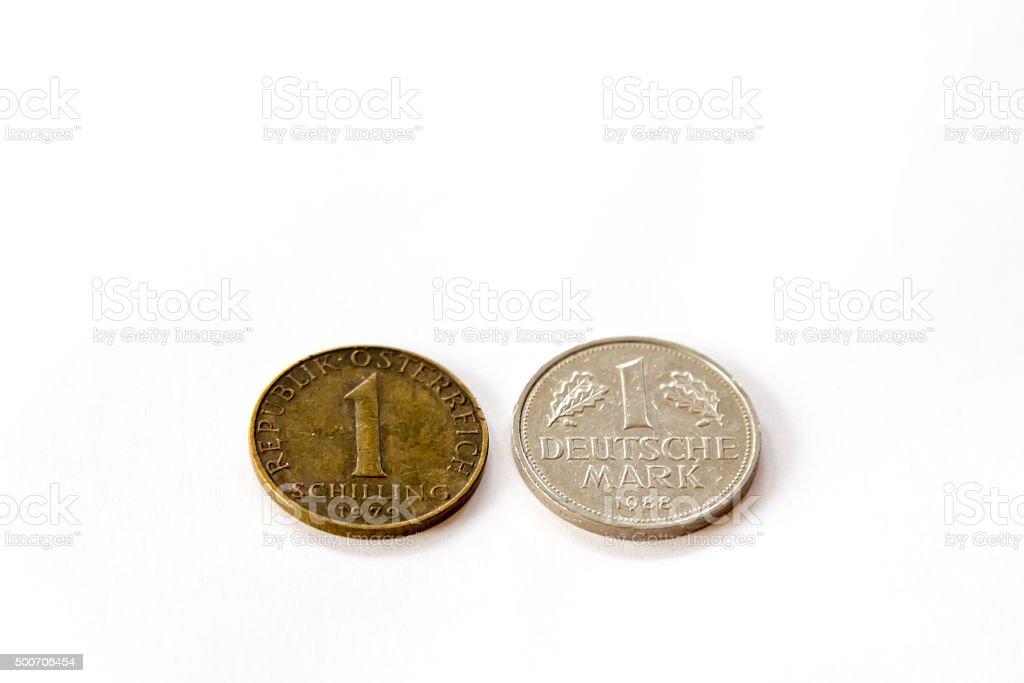 Obsolete money - one Austrian schilling and German Deutsche Mark stock photo