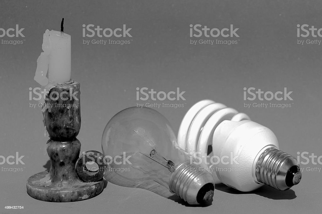 Obsolete, old and new light concept stock photo