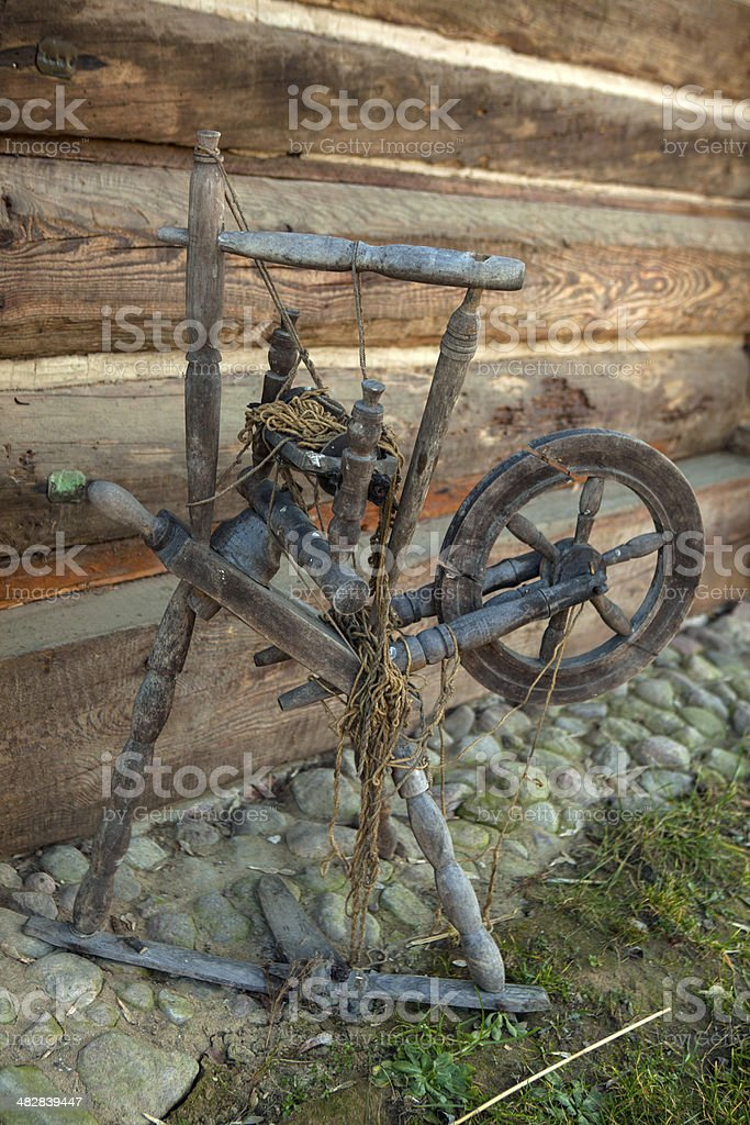 Obsolete reel spindle in a rural open-air museum stock photo
