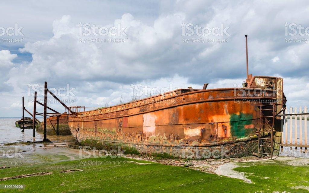 Obsolete ships in disused ship yard, Paull, Yorkshire, UK. stock photo