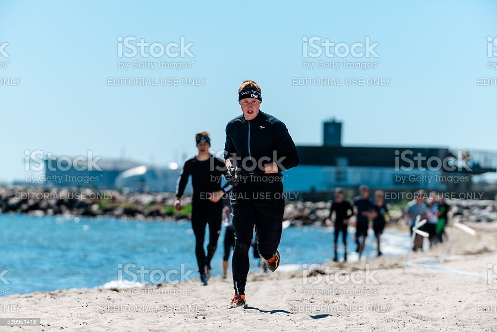 Obstacle course run on beach at the sea stock photo